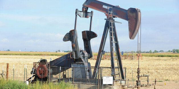 WELD COUNTY, CO - SEPTEMBER 14: An oil pump or pump jack in a field with energy development still going...