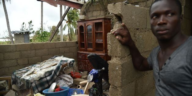 Stanley stands in his destroyed house after the passing of Hurricane Matthew, in Les Cayes, in Southwest...