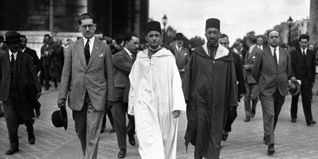 The Sultan of Morocco, Mohammed V wearing white robes, walking with the Grand Vizier, Si Mohammed El...