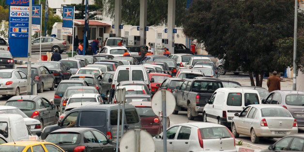 Automobiles line up for gasoline at a Staroil gas station in Tunis after the announcement of a strike...