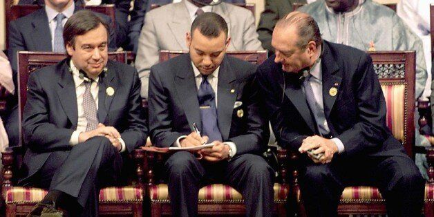 French President Jacques Chirac (R) looks over the shoulder of King Mohammed VI of Morocco as they sit...