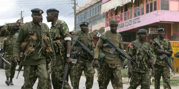 Kenyan Army soldiers patrol the centre of the town of Naivasha January 27, 2008. At least 10 people were...
