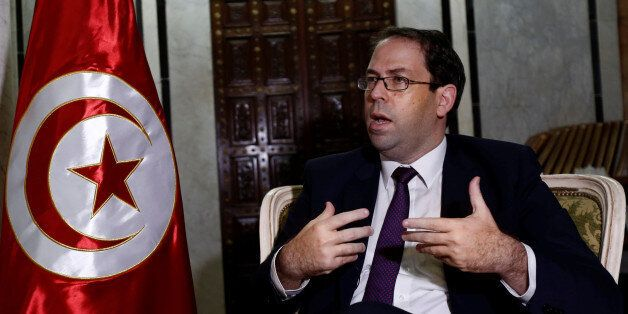 Tunisia's Prime Minister Youssef Chahed talks during an interview with Reuters in Tunis, Tunisia, September...