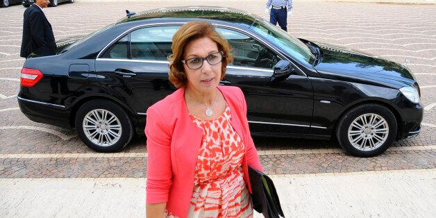 New Tunisian Finance Minister Lamia Zribi arrives for her first cabinet meeting in Tunis, Wednesday Aug....