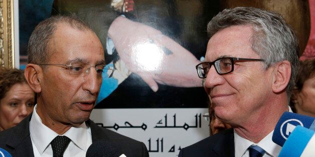 Moroccan Interior Minister, Mohamed Hassad, and his German counterpart, Thomas de Maiziere, right, speak...