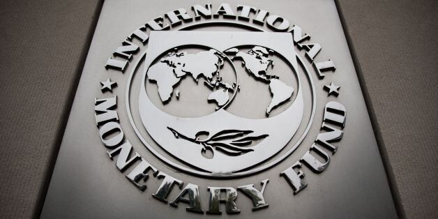The International Monetary Fund logo is pictured at IMF Headquarters September 30, 2016 in Washington,...