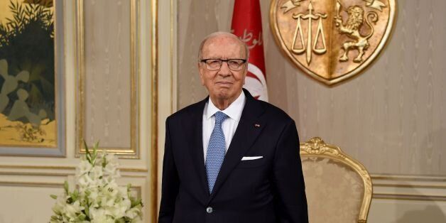 Tunisian President Beji Caid Essebsi waits prior to appointing Tunisia's newly appointed prime minister-delegate...