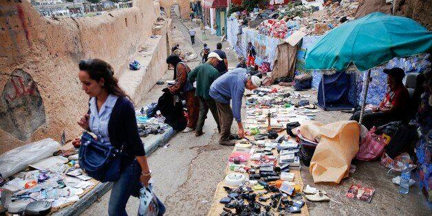 People look for items at a small flea market behind Bab el Bahr gates of Rabat's Medina September 21,...