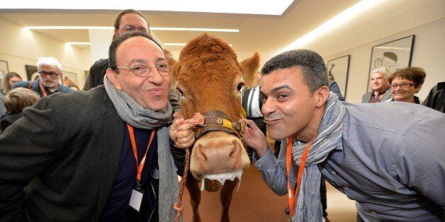 Belgian and Israeli author and cartoonist Michel Kichka (L) and Moroccan cartoonist Khalid Gueddar pose...