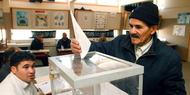 A man deposits his ballot paper after voting in Rabat, Morocco, Friday, Nov. 25, 2011. Moroccans voted...