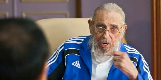 Cuba's former leader Fidel Castro talks with China's Premier Li Keqiang in Havana, Cuba, Sunday, Sept....
