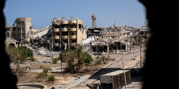 TOPSHOT - A general view shows destroyed buildings in the District 3 neighbourhood of Sirte, the last...