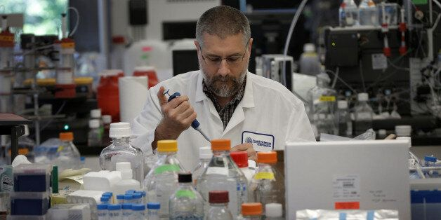 Research scientist Dan Galperin works on Purified Recombinant Zika Enveloped Protein in his laboratory...