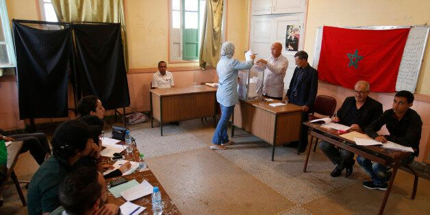 A Moroccan woman casts her ballot at a polling station for the parliamentary elections, in Rabat, Morocco,...