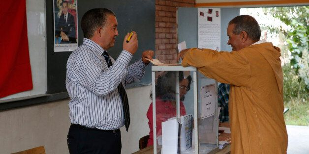 A man casts her ballot at a polling station for the parliamentary elections, in Rabat, Morocco, Friday,...