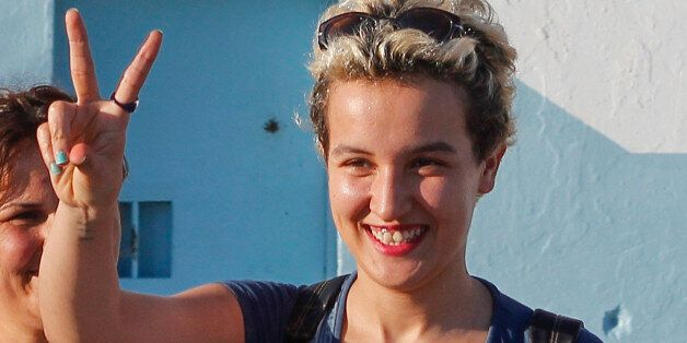 Amina Sboui, the Tunisian member of the Ukrainian feminist group Femen, gestures after she is released...