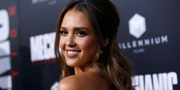 Cast member Jessica Alba poses at the premiere for the