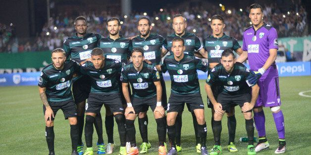 CORRECTION - Soccer team MO Bejaia poses for photographers before their game against FUS Rabat in the...
