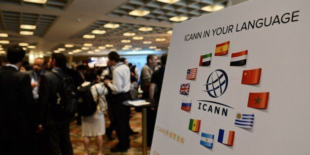 Participants take a break after the Internet Corporation for Assigned Names and Domain (ICANN) opening...