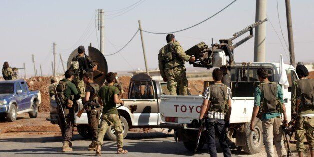 ALEPPO, SYRIA - OCTOBER 15: Members of Free Syrian Army (FSA), Turkish artillery units and coalition...