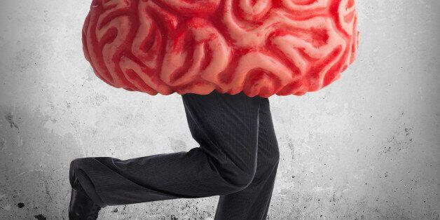 Metaphor of the brain drain. Rubber brain legs while