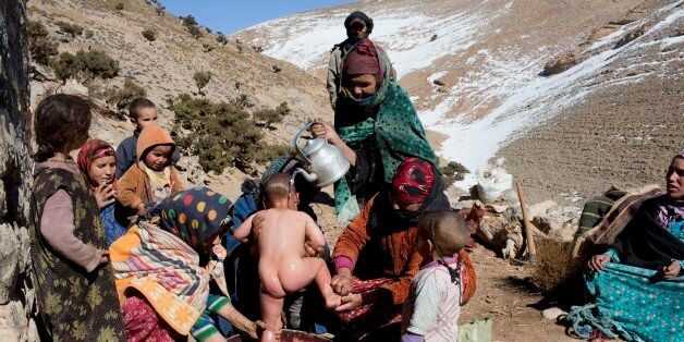 Berber women wash a child in Ait Sghir village in the High Atlas region of Morocco February 14, 2015....