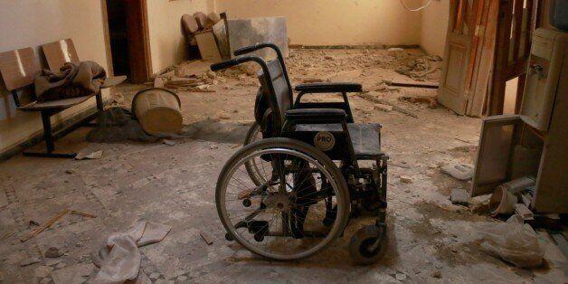 ALEPPO, SYRIA - OCTOBER 01: An unusable wheel chair is seen inside the Sahra Hospital after a barrel...