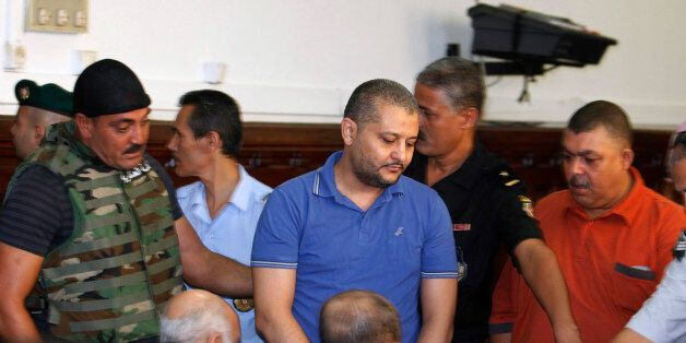 Imed Trabelsi (C), a nephew of ousted Tunisian President Zine al-Abidine Ben Ali, arrives for a third...