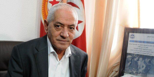 Houcine Abassi, secretary general of the Tunisian General Labour Union (UGTT), poses for a photograph...