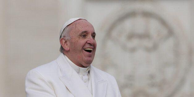 The pontifex Francis (Jorge Mario Bergoglio) smiling during the audience with the Padre Pio prayer groups...