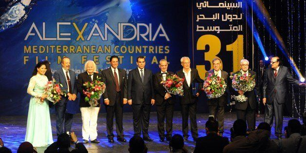 Prize winners of the Alexandria Mediterranean countries film festival stand on stage during the opening...