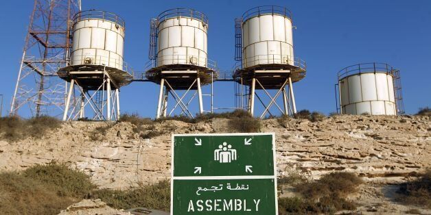A picture shows silos at the Zueitina oil terminal on September 14, 2016.Forces opposed to Libya's unity...