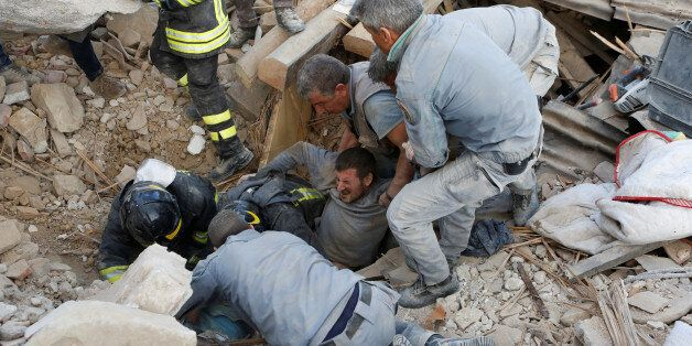 A man is rescued alive from the ruins following an earthquake in Amatrice, central Italy, August 24,...
