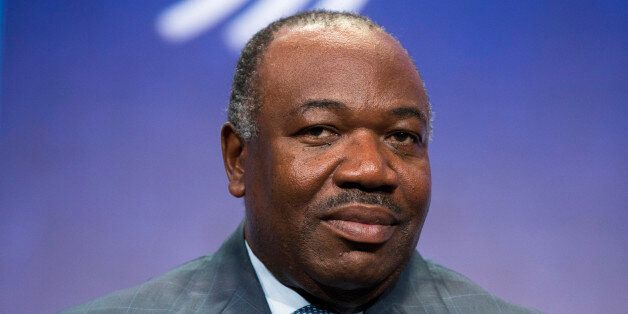 President of Gabon, Ali Bongo Ondimba, sits on stage in support of a commitment to stop poaching of African...
