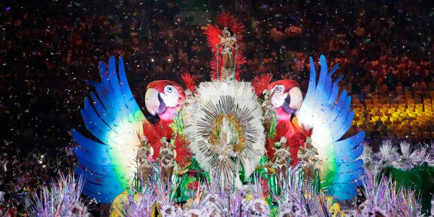 Plumed figures appear as part of the closing ceremony in the Maracana stadium at the 2016 Summer Olympics...