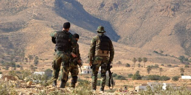 Special forces from the Tunisian National Guard take part in a security sweep in the mountainous Tounine...