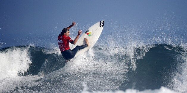 French surfer Diego Mignot rides his wave at Casablanca Beach, also known as the Pepsi spot during the...