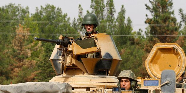 Turkish soldiers on an armoured vehicle are seen in Karkamis on the Turkish-Syrian border in the southeastern...