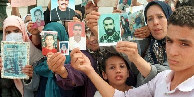ALGIERS, ALGERIA: Families of missing victims of terrorism in Algeria hold a weekly demonstration at...