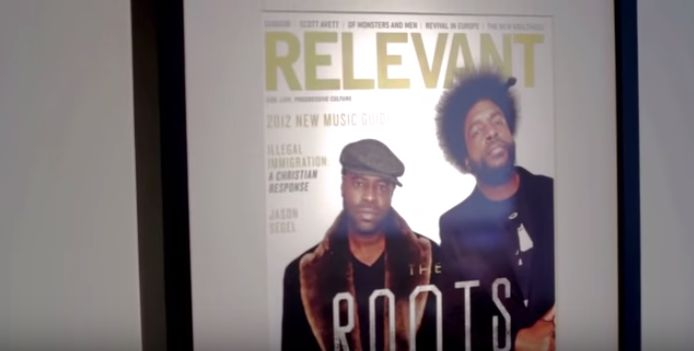 "A Relevant magazine cover featuring an image of The Roots band is featured in a <a href=""https://www.youtube.com/watch?v=Kq4m"