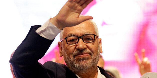 Rached Ghannouchi, leader of Tunisia's main Islamist Ennahda party, waves while arriving for campaign...
