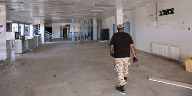 A picture shows on August 15, 2016 a Libyan fighter walking at the Ibn Sina Hospital in Sirte, east of...