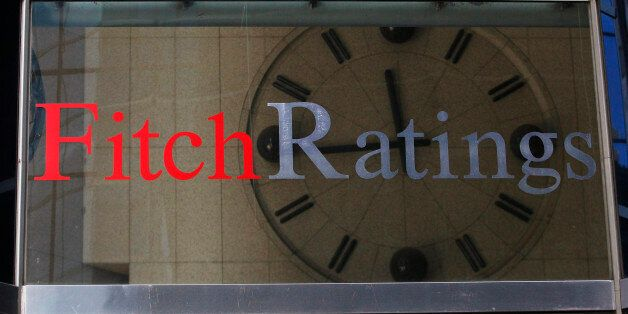 A clock is seen inside the lobby of the headquarters of Fitch Ratings headquarters in New York, February...