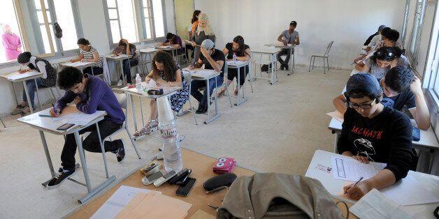 Tunisian students take the baccalaureat (high school graduation exam) exam on June 6, 2012 in Tunis....