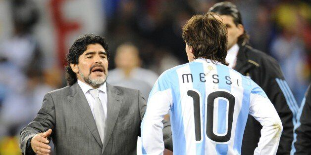 Argentina's coach Diego Maradona (L) looks dejected in front of Argentina's striker Lionel Messi after...