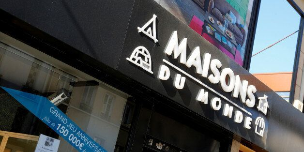 The logo of French furniture and interior decoration company Maisons du Monde is seen on the facade of...