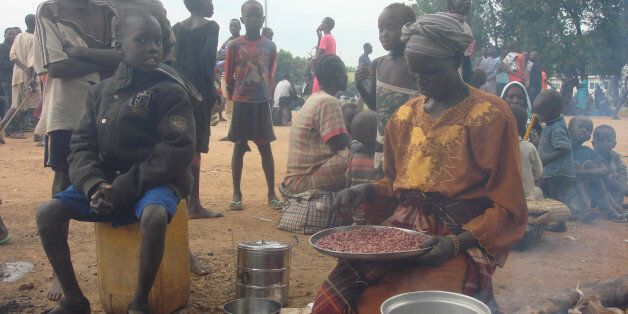A displaced South Sudanese woman prepares a meal in a camp for internally displaced people in the UNMISS...