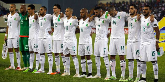 Algeria's national soccer team players listen to their national anthem before their quarter-final soccer...