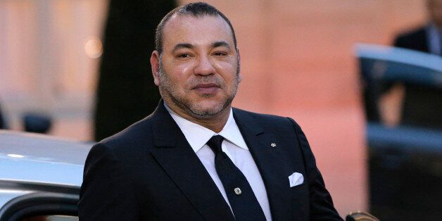 Morocco's King Mohammed VI poses as he leaves after a meeting with France's President Francois Hollande...