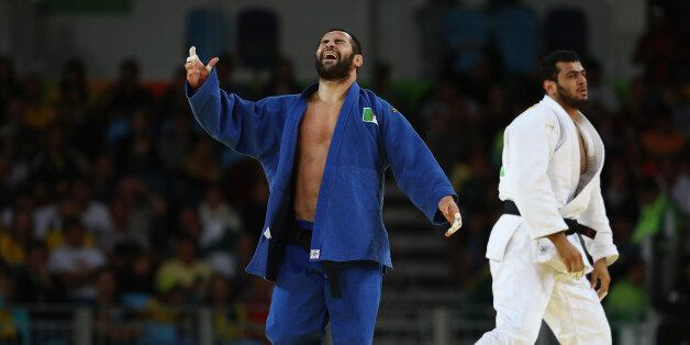 RIO DE JANEIRO, BRAZIL - AUGUST 11: Lyes Bouyacoub of Algeria reacts during the men's -100kg elimination...